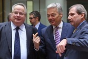 (From L) Greek Foreign Minister Nikos Kotzias, Belgium's Foreign Minister Didier Reynders and European Commissioner Johannes Hahn attend an EU foreign ministers meeting at the European Council, in Brussels, on January 16, 2017..British foreign minister Boris Johnson said on January 16, 2017 the Iran nuclear accord that US President-elect Donald Trump has threatened to tear up must be maintained.. / AFP / EMMANUEL DUNAND