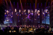 (L-R) Vince Gill, Timothy B. Schmit, Don Henley, Scott F. Crago, Deacon Frey, Joe Walsh and Steuart Smith of the Eagles perform with an orchestra at MGM Grand Garden Arena on September 27, 2019 in Las Vegas, Nevada.