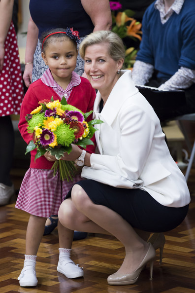 Sophie, Countess of Wessex receives flowers during an official visit on the Earl's 50th Birthday at Robert Browning Primary School on March 10, 2014 in London, England.