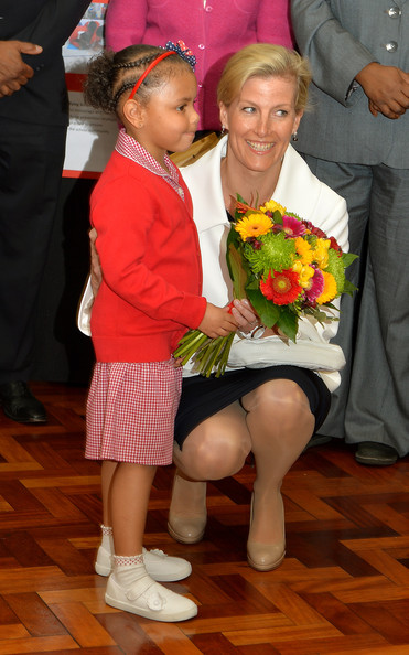 Sophie, Countess of Wessex is presented with flowers by Sofia Jardine-Kerr, five, during an official visit on the Earl's 50th Birthday to Robert Browning Primary School in Walworth to see the work of youth charity Kidscape, recipients of grants from the Wessex Youth Trust, on March 10, 2014 in London, United Kingdom.