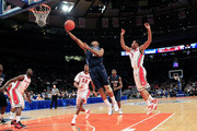 Maalik Wayns #2 of the Villanova Wildcats lays the ball up past Jerome Seagears #1 of the Rutgers Scarlet Knights during their first round game of the 2012 BIG EAST Men's Basketball Tournament at Madison Square Garden on March 6, 2012 in New York City.