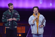 (L-R) Rea Garvey and 'Best Band - Pop National' award winner Clemens Rehbein of Milky Chance celebrate during the Echo Award show at Messe Berlin on April 12, 2018 in Berlin, Germany.