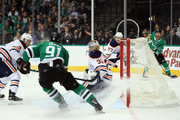 Cam Talbot #33 of the Edmonton Oilers gives up a goal against Jamie Benn #14 of the Dallas Stars in the first period at American Airlines Center on January 6, 2018 in Dallas, Texas.
