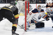 Cam Talbot #33 of the Edmonton Oilers blocks a shot by Jonathan Marchessault #81 of the Vegas Golden Knights as Andrej Sekera #2 of the Oilers defends in the second period of their game at T-Mobile Arena on January 13, 2018 in Las Vegas, Nevada. The Oilers won 3-2 in overtime.