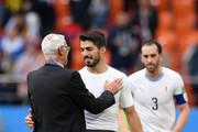 Luis Suarez of Uruguay speaks with Hector Cuper, Head coach of Egypt following the 2018 FIFA World Cup Russia group A match between Egypt and Uruguay at Ekaterinburg Arena on June 15, 2018 in Yekaterinburg, Russia.
