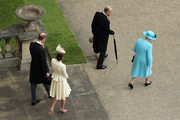 (L-R) Prince William, Duke of Cambridge, Catherine, Duchess of Cambridge, Prince Philip, Duke of Edinburgh and Queen Elizabeth II arrive to greet guests attending a garden party at Buckingham Palace on May 24, 2016 in London, England.
