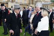 Prince Philip, Duke of Edinburgh greets guests attending a garden party at Buckingham Palace on May 24, 2016 in London, England.