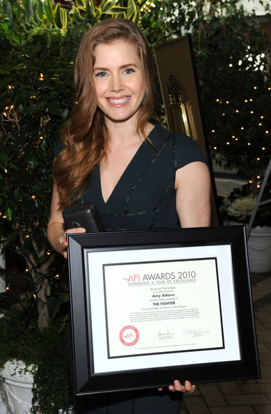 "Actress Amy Adams presents ""Year of Excellance"" Award for her role in ""The Fighter"" at the Eleventh Annual AFI Awards presentation at the Four Seasons Hotel on January 14, 2011 in Los Angeles, California."