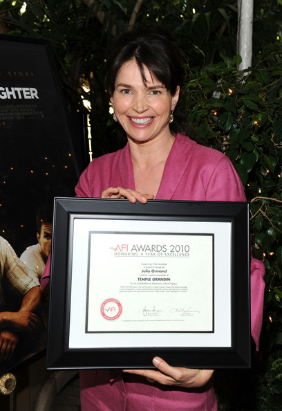 "Actress Julia Ormond poses with ""Year of Excellance"" Award for ""Temple Grandin"" at the Eleventh Annual AFI Awards presentation at the Four Seasons Hotel on January 14, 2011 in Los Angeles, California."
