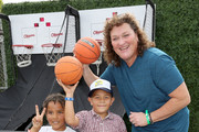 Actress Dot Marie Jones plays basketball with kids during the Elizabeth Glaser Pediatric AIDS Foundation 26th Annual A Time For Heroes Family Festival at Smashbox Studios on October 25, 2015 in Culver City, California.