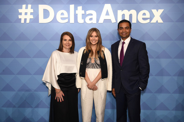 American Express And Delta Air Lines Celebrate #DeltaAmex Card Relaunch [award,event,fashion,award ceremony,company,ceremony,business,formal wear,white-collar worker,brand,deltaamex,card relaunch,svp loyalty,l-r,elizabeth olsen,sandeep dube,executive vice president,eva reda,delta air lines,american express]