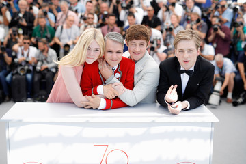 Elle Fanning John Cameron Mitchell 'How to Talk to Girls at Parties' Photocall - The 70th Annual Cannes Film Festival
