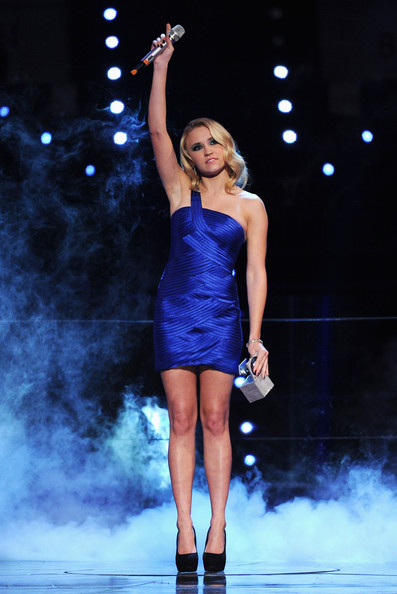 Emily Osment Emily Osment presents an awards during the MTV Europe Music Awards 2010 live show at La Caja Magica on November 7, 2010 in Madrid, Spain.