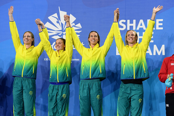 Swimming - Commonwealth Games Day 6 [product,social group,team,workwear,outerwear,fun,high-visibility clothing,crew,cheering,gesture,medley relay final,gold medalists,emily seebohm,emma mckeon,georgia bohl,bronte campbell,australia,womens 4,commonwealth games,medal ceremony]