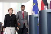 Sheikh Tamim bin Hamad Al Thani, the eighth and current Emir of the State of Qatar (R), arrives for a press conference with German Chancellor Angela Merkel on September 17, 2014 in Berlin, Germany. The Qatari monarch, known for his support of sporting events and his position as head of the Qatar Investment Authority board of directors, is visiting Berlin and Bavaria on his trip to the country.