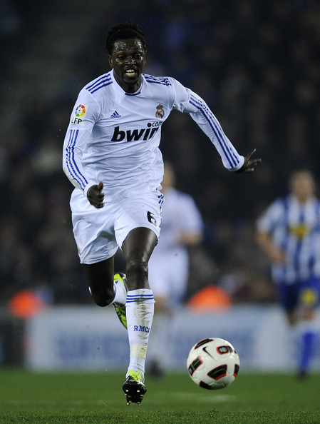 Emmanuel Adebayor Emmanuel Adebayor of Real Madrid runs with the ball during La Liga match between RCD Espanyol and Real Madrid at Estadi Cornella-El Prat on February 13, 2011 in Barcelona, Spain. Real Madrid won 0-1.