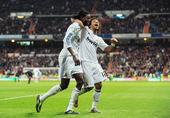 Emmanuel Adebayor Emmanuel Adebayor (L) of Real Madrid celebrates with Marcelo after scoring Real's fourth goal during the La Liga match between Real Madrid and Real Sociedad at Estadio Santiago Bernabeu on February 6, 2011 in Madrid, Spain.