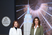 Delivering Good President and CEO Lisa Gurwitch and Cindy Crawford attend the Empire State Building in celebration of International Women's Day in partnership with Delivering Good and Jones New York on March 03, 2020 in New York City.