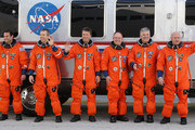 (R-L) Commander Mark Kelly, Pilot Gregory H. Johnson, Mission Specialists Michael Fincke, European Space Agency astronaut Roberto Vittori, Andrew Feustel and Greg Chamitoff, pose for photos while participating in a 4 day Terminal Countdown Demonstration Test (TCDT), at the Kennedy Space Center, on April 1, 2011 in Cape Canaveral, Florida. The TCDT , culminated in a full dress rehearsal for the planned April 19th launch of Space Shuttle Endeavour's final scheduled flight to the International Space Station before being retired.
