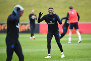 Danny Welbeck reacts towards team mate Ashley Young during an England training session on the eve of their international friendly against the Netherlands at St Georges Park on March 22, 2018 in Burton-upon-Trent, England.