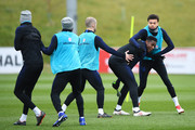 Deli Alli and Danny Welbeck take aprt in a drill with team mates during an England training session on the eve of their international friendly against the Netherlands at St Georges Park on March 22, 2018 in Burton-upon-Trent, England.