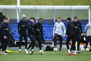 Alex Oxlade-Chamberlain and Danny Welbeck take part in a drill with team mates during an England training session on the eve of their international friendly against the Netherlands at St Georges Park on March 22, 2018 in Burton-upon-Trent, England.