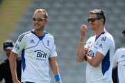 Kevin Pietersen of England speaks with Stuart Broad during an England nets session at Eden Park on March 21, 2013 in Auckland, New Zealand.