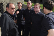 (L-R)  Avram Grant looks on with Jack Butland, Andy Carroll and Wayne Rooney during a visit by an England Football Association delegation to the Auschwitz-Birkenau memorial and former concentration camp, ahead of UEFA Euro 2012, on June 8, 2012 in Oswiecim, Poland.