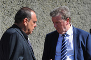 England manager Roy Hodgson speaks to Avram Grant (L) during a visit by an England Football Association delegation to the Auschwitz-Birkenau memorial and former concentration camp, ahead of UEFA Euro 2012, on June 8, 2012 in Oswiecim, Poland.