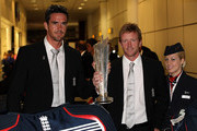 Kevin Pietersen (L) and Captain, Paul Collingwood of England arrive with the World Twenty20 Cup Trophy as they return to Gatwick Airport on May 18, 2010 in London, England.