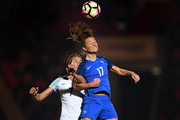 Gaetane Thiney of France battles with Jill Scott of England during the International Friendly between England and France at Keepmoat Stadium on October 21, 2016 in Doncaster, England.