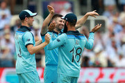 Mark Wood (C) of England celebrates with team mates Moeen Ali (R) and  Chris Woakes after taking the wicket of Glenn Maxwell during the Group Stage match of the ICC Cricket World Cup 2019 between England and Australia at Lords on June 25, 2019 in London, England.