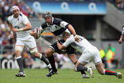 Joe van Niekerk of Barbarians is tackled by Mike Brown of England during the match between England and Barbarians at Twickenham Stadium on May 29, 2011 in London, England.