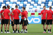 Belgium players speak during a pitch inspection prior to the 2018 FIFA World Cup Russia group G match between England and Belgium at Kaliningrad Stadium on June 28, 2018 in Kaliningrad, Russia.
