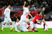 Hossam Ghaly of Egypt tackles Gareth Barry of England during the International Friendly match between England and Egypt at Wembley Stadium on March 3, 2010 in London, England.