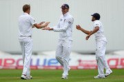 Stuart Broad (L) of England celebrates taking the wicket of Ishant Sharma of India with team mate Kevin Pietersen during day four of the 3rd npower Test at Edgbaston on August 13, 2011 in Birmingham, England.