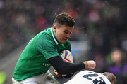 Jacob Stockdale of Ireland is tackled by Mike Brown of England during the NatWest Six Nations match between England and Ireland at Twickenham Stadium on March 17, 2018 in London, England.