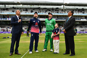 Eoin Morgan of England tosses the coin alongside William Porterfield of Ireland prior to the Royal London One Day International between England and Ireland at Lord's Cricket Ground on May 7, 2017 in London, England.
