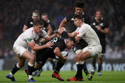 Ryan Crotty of New Zealand All Blacks is tackled by Owen Farrell and Ben Youngs of England during the Quilter International match between England and New Zealand at Twickenham Stadium on November 10, 2018 in London, United Kingdom.