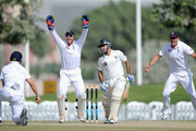 Jonathan Trott, Matt Prior and Kevin Pietersen of England celebrate the wicket of Sarfraz Ahmed of Pakistan Cricket Board XI during the tour match between England and Pakistan Cricket Board XI at ICC Global Academy on January 12, 2012 in Dubai, United Arab Emirates.