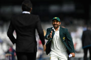 Pakistan captain Sarfraz Ahmed goes to shale hands with Wasim Akram before day one of the second Test Match between England and Pakistan at Headingley on June 1, 2018 in Leeds, England.