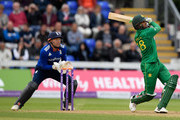 Pakistan batsman Shoaib Malik hits a six off Liam Dawson watched by Jonny Bairstow during the 5th One Day International between England and Pakistan at Swalec Stadium on September 4, 2016 in Cardiff, Wales.