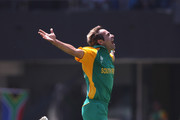 Imran Tahir of South Africa celebrates taking the wicket of Jonathan Trott of England during the  2011 ICC World Cup Group B match between England and South Africa at the M. A. Chidambaram Stadium on March 6, 2011 in Chennai, India.