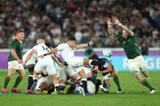 Ben Youngs of England performs a box kick as RG Snyman of South Africa attempts to charge down during the Rugby World Cup 2019 Final between England and South Africa at International Stadium Yokohama on November 02, 2019 in Yokohama, Kanagawa, Japan.