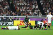 Kyle Sinckler of England (L) lays on the ground after being hit high by Makazole Mapimpi of South Africa during the Rugby World Cup 2019 Final between England and South Africa at International Stadium Yokohama on November 02, 2019 in Yokohama, Kanagawa, Japan.