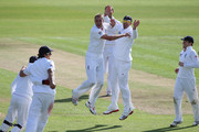 Stuart Broad (3L) celebrates with Kevin Pietersen (2R) after taking the final wicket of Suranga Lakmal and victory by an innings and 14 runs during day five of the 1st npower test match between England and Sri Lanka at the Swalec Stadium  on May 30, 2011 in Cardiff, Wales.