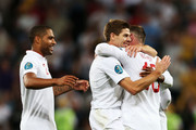 Wayne Rooney of England celebrates scoring their first goal with Steven Gerrard and Glen Johnson during the UEFA EURO 2012 group D match between England and Ukraine at Donbass Arena on June 19, 2012 in Donetsk, Ukraine.