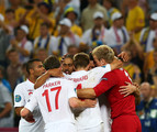 Ashley Cole, Scott Parker, Glen Johnson, Steven Gerrard, John Terry and Joe Hart of England celebrate victory and progress to the quarter-finals during the UEFA EURO 2012 group D match between England and Ukraine at Donbass Arena on June 19, 2012 in Donetsk, Ukraine.