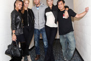 """(L-R) Cassie, Erin Heatherton, singer Enrique Iglesias, Adriana Lima and guest pose with guests during the Enrique Iglesias 2011 """"Euphoria"""" tour at the Prudential Center on September 24, 2011 in Newark, New Jersey."""