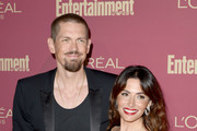 (L-R) Steve Howey and  Sarah Shahi attend the 2019 Pre-Emmy Party hosted by Entertainment Weekly and L'Oreal Paris at Sunset Tower Hotel in Los Angeles on Friday, September 20, 2019.